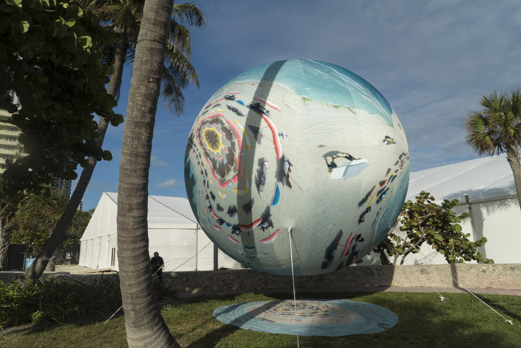 Adrift on Titan (Miami Marbles series) at PULSE Contemporary Art Fair Miami Beach, FL, 2016. The first PULSE PROJECTS Special Commission, Miami Marbles is a mixed augmented reality (AR) installation combining AR components, via a custom app, with nine physical helium-filled spheres—ranging from seven to 16 feet in diameter— printed with digitally manipulated footage of Miami Beach; Courtesy of Anne Spalter